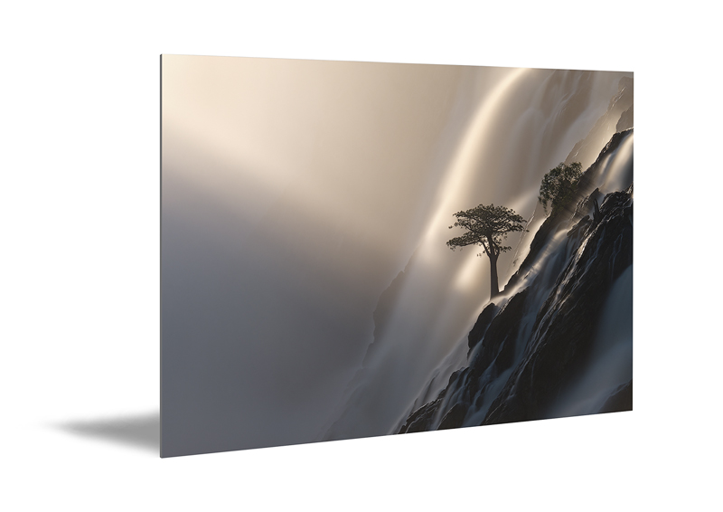 Large photo print on aluminum shows an art photo of a waterfall as a print.