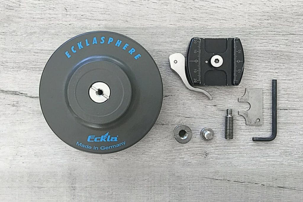 ECKLASPHERE Sphere with quick release bracket including the tools to attach the quick release. All lying on the ground