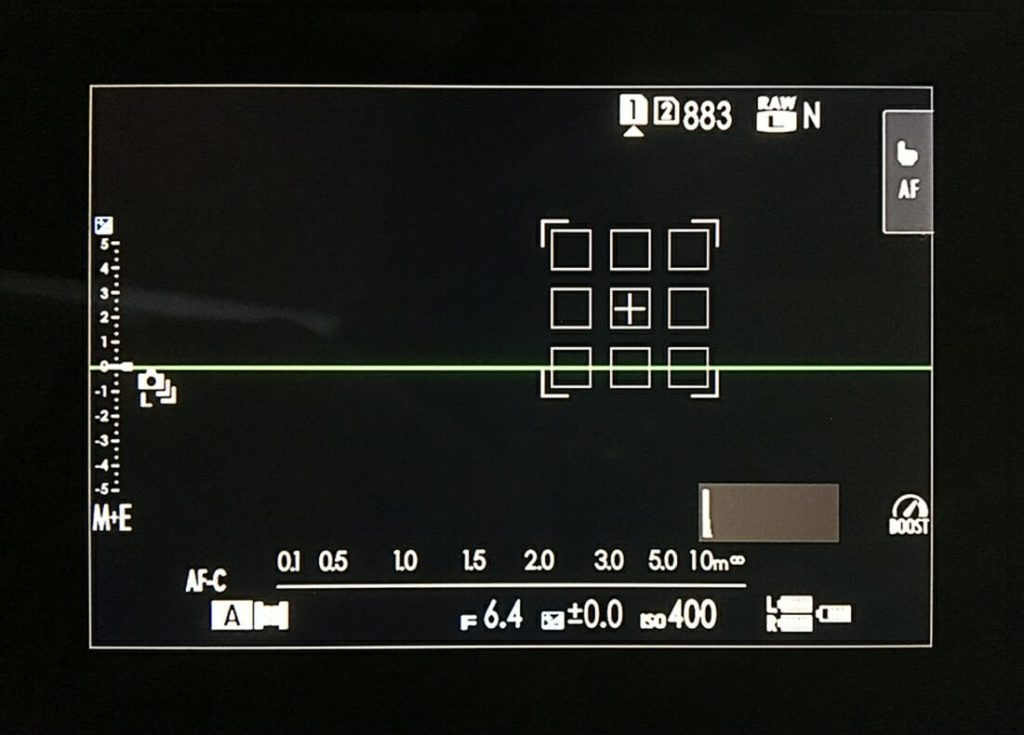 Switched From Canon Cameras to FujiFilm, FujiFilm X-H1 LCD Monitor showing camera settings on screen, same you see when you look the viewfinder