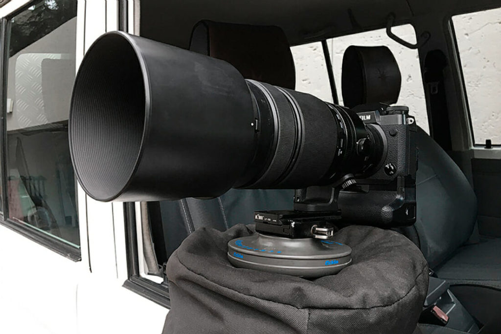 FujiFilm X-H1 attached to a Eckla Sphere base, which sits on a big beanbag on a open car window pointing to the outside