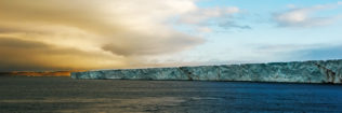 The famous Austfonna glacier is flowing into the Arctic sea. On the left, you see impressive clouds. (copyright Anette Mossbacher)
