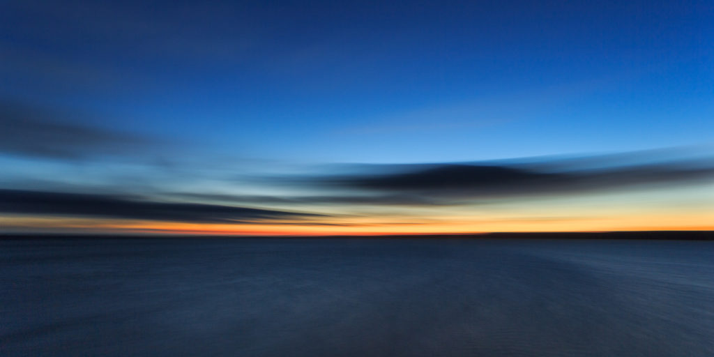 A beautiful colorful Arctic sunset is above the Arctic ocean. Due to extended exposure, the sea became soft. (copyright Anette Mossbacher)