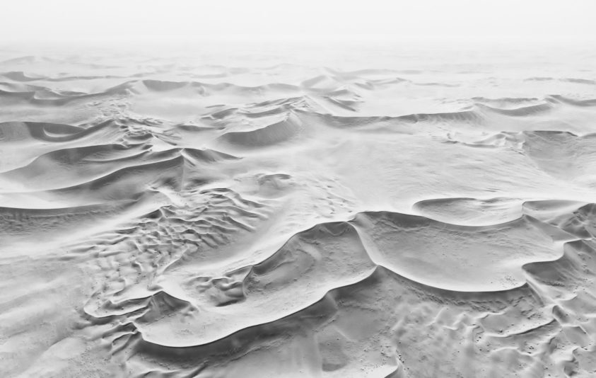 Beautiful dunes are in this B&W desert photograph. An areal view of the endless Namib desert. (copyright Anette Mossbacher)