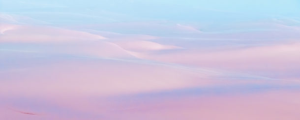 That landscape photograph shows translucent colors. All cohesively merge along in the dunes. (copyright Anette Mossbacher)
