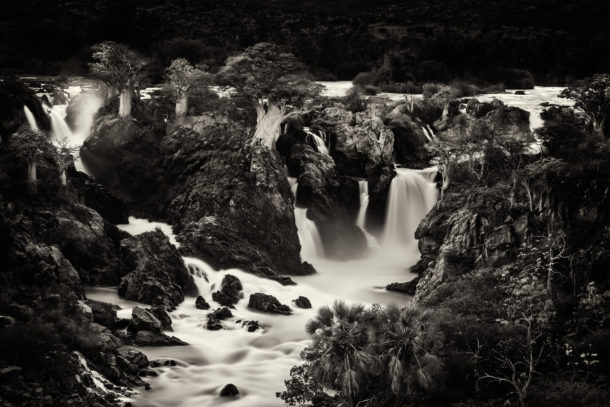 Fine art limited-edition photograph in black and white of a waterfall landscape. The beautiful Epupa Falls. (copyright Anette Mossbacher)