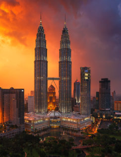 The unique Petronas twin towers at sunset look quite impressive. A tropical storm is coming. (copyright Anette Mossbacher)