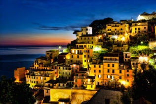 Riomaggiore at night. It is situated in the famous Cinque Terre – a World Heritage site in Italy. (copyright Anette Mossbacher)