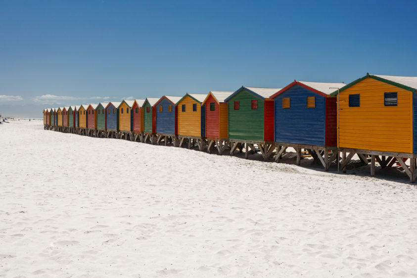 Charming, colorful beach huts in a row are an idyllic feature to a beautiful South African beach. colorful beach huts in a row are an idyllic feature to a beautiful South African beach. (copyright Anette Mossbacher)