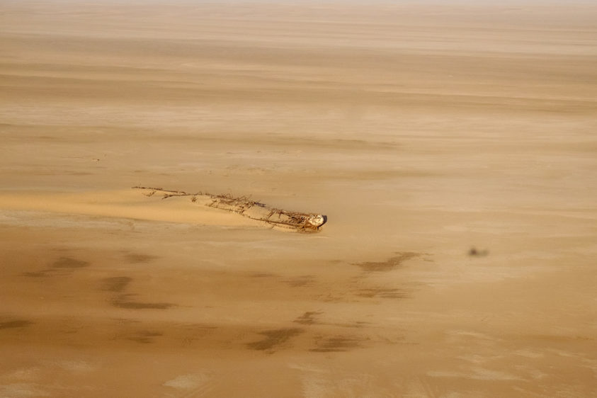 That is an areal photograph of the shipwreck Eduard Bohlen at the Namibian coast. (copyright Anette Mossbacher)