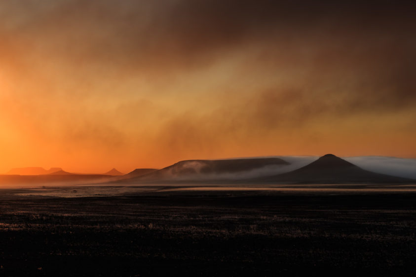 Landscape photograph of the Skeleton coast with fog. The early morning creates a hazy effect. (copyright Anette Mossbacher)